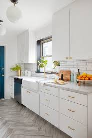 white kitchen cabinets with gold pulls white cabinets with gold hex knobs contemporary