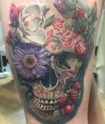 flowers and skull on side thigh