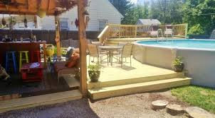 above ground pool deck tiki bar sunburst railing deck stairs