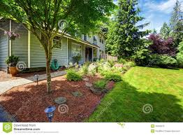 beautiful landscape design with sawdust flower bed and lawn stock