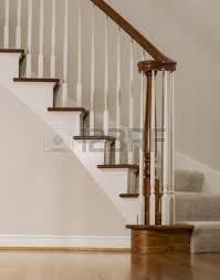staircase with decorative railing and white walls stock photo