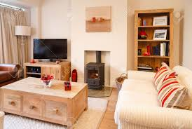 contemporary living rooms contemporary living room with neutral colors wood burner and