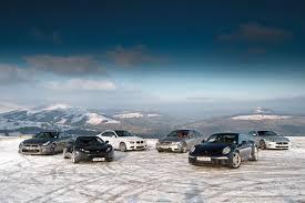 porsche 911 snow porsche 911 vs nissan gt r jaguar xkr bmw m3 lotus evora c63