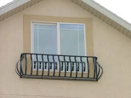 wrought iron window rail window above garage for the home