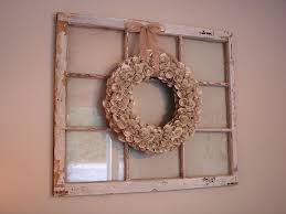 bouquet placed on decorated window frames from wood hanging on
