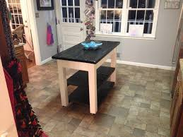 roll around kitchen island unpolished walnut hardwood rolling chart island with black iron