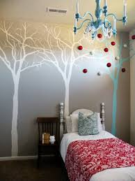 tree wall mural ideas in small bedroom with blue throw pillow