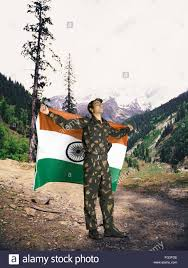 Army Flag Pictures Indian Army Soldier Holding National Flag On His Backside Mountain