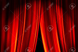 theatre stage red curtains opening for a live performance stock