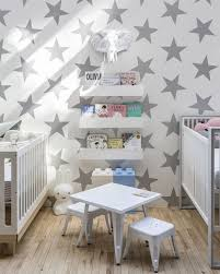 Stars Nursery Decor by Nursery Room With Double Cribs And Stars Nursery Wallpaper