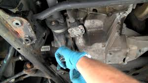 changing fluid in bmw 4wd front differential under car fluid