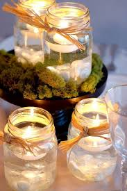 Wedding Centerpieces Floating Candles And Flowers by Mason Jar Centerpieces With Candles Mason Jars Floating Candles
