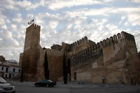 in the impressive Gate of Seville fortress  dating to the  th century BC  or to the Alcazar castle  now home to one of the best Parador hotels in Spain  Academia Oxford Carmona