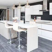 kitchen cabinets what to look for when buying your units modern white handleless kitchen with black walls