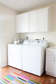 Laundry Room Pictures To Hang - how to hang a wall cabinet the easy way a pinch of joy great