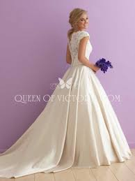 ivory satin and lace cap sleeve traditional ball gown wedding