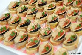 canapé au foie gras crostini with foie gras canape and slices of fig stock photo and