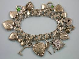 sterling bracelet with heart charm images The love nest charmed i 39 m sure a collection of charm bracelets jpg