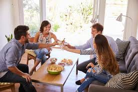 home entertaining couple entertaining friends at home stock image image of person
