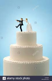 and groom wedding cake toppers and groom wedding cake topper with runaway groom stock photo