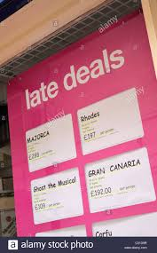 late deals in uk travel agency window stock photo royalty free
