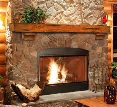 attractive rustic stoned fireplace mantel texture with glass
