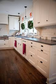 white kitchen cabinets with slate countertops white cabinets honed slate counter tops black handles