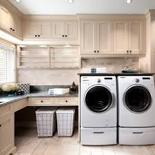 washer dryer pedestal laundry room traditional with blinds counter