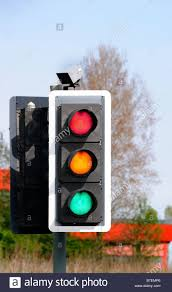 traffic lights showing green all three lights on at once