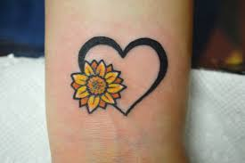 tiny tattoo sunflower heart wrist tattoo artist adrienne haberl
