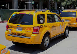 Ford Escape Yellow - hidden costs of eco friendly vehicles