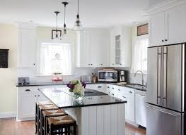 white l shaped kitchen with island seagrass counter stools cottage kitchen beth design