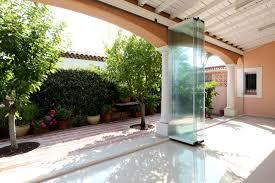 pare vent verre fermeture en verre sans profils verticaux terrasse veranda balcon