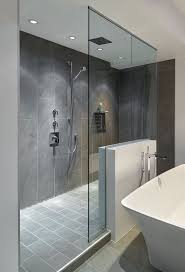best 20 gray shower tile ideas on pinterest large tile shower large walk in doorless shower with gray slate tiles and a floating glass wall creates