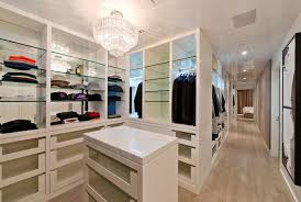 closet under bed clothes hanger attached on beige painted wall small bedroom into a