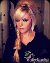 poof at the crown hairstyle fishtail braid with poof at crown for that mod glam look this
