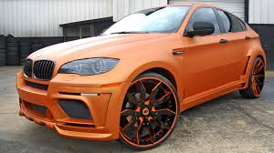 matte burnt orange hamman widebody bmw x6 by butler tire rides