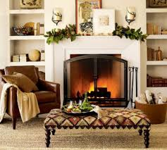 the upholstered bench in front of the fireplace for the