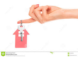 hand holds key with a keychain the shape of house stock photo
