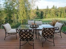 Modern Garden Table And Chairs Furniture Cast Aluminum Patio Furniture With Brown Wooden Floor