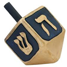 the dreidel is a 4 sided wooden or clay top that has a hebrew