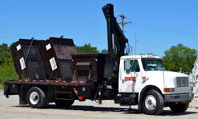 have you ever wondered how rumpke delivers trash containers to a