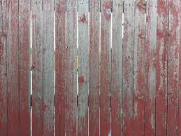 weathered red painted wood fence texture picture free photograph