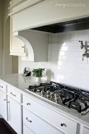 Subway Tile Backsplash Ideas For The Kitchen by White Cabinets White Kitchen White Subway Tile Pot Filler Lyra