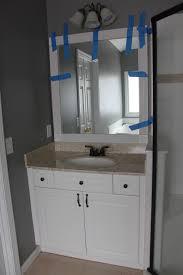 Framing Builder Grade Bathroom Mirror My Enroute Life Framimg Our Master Bathroom Builder Grade Mirrors