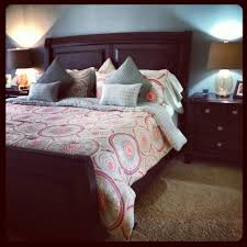 spa blue and red bedroom with dark furniture cynthia rowley