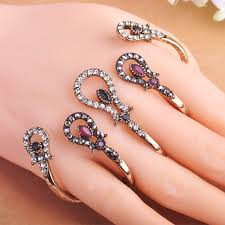 hand with rings images Hot selling vintage women rings four fingers hand accessories jpg