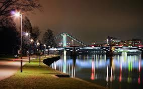 other city grass pier lake walk evening lights park