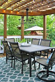 our beautiful outdoor dining room from thrifty decor chick light blue outdoor rug
