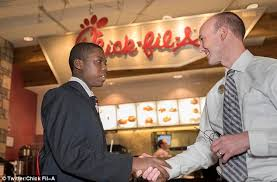 fake target employee black friday teen shown how to tie a tie by a target employee lands chic fil a
